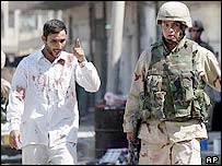 Soldier and Iraqi civilian