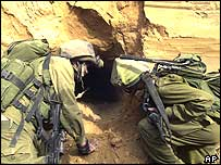 Israeli soldiers inspecting what they say is a weapons smuggling tunnel