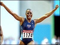 American Kelli White celebrates her 100m gold