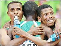 Kenenisa Bekele (left) hugs his Ethiopian team-mates Sileshi Siline and Haile Gebrselassie