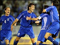 Greece's Zisis Vrizas celebrates with his team after Greece scored the winning goal against Northern Ireland