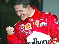 Michael Schumacher celebrates at the end of the race