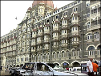 A car damaged in the blast in front of the Taj Mahal Hotel,Bombay
