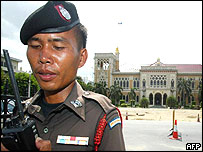 A Thai security officer guarding a government building in Bangkok
