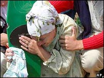 Woman grieving at Srebrenica burial service