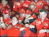 Michael Schumacher celebrates with his Ferrari team at Suzuka