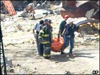 Rescuers carry out a body from the World Trade Center