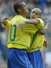 Brazil striker Rivaldo (left) and goal scorer Roberto Carlos