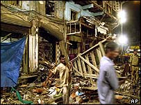 Civic workers clear debris at the site of a bomb blast at Zaveri Bazaar in Bombay