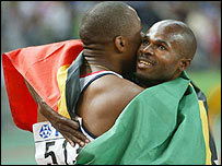 Darren Campbell (left) congratulates new 100m world champion Kim Collins