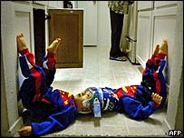 Mohammed and Ahmed Ibrahim playing on the kitchen floor at their home in Dallas