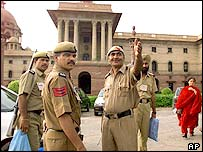 Indian policeman prepare to guard the Presidential Palace complex in Delhi