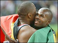Kim Collins is congratulated by Darren Campbell