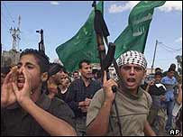 Palestinians protest at a funeral