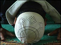 Muslim at prayer in the Central Mosque in Birmingham, England