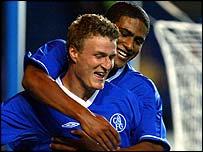 Chelsea's goalscorers Robert Huth and Glen Johnson celebrate