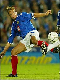 Teddy Sheringham in action against Bolton