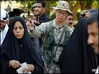 US soldier supervises Iraqi welfare queue