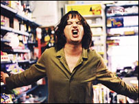 Phil Cornwell as a corner shop owning Mick Jagger in Stella Street