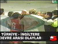 Referee Pierluigi Collina tries to control the melee between England and Turkey players