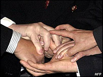 The six sides join hands symbolically at the start of the talks