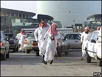 Saudi men flee police during the rally in Riyadh