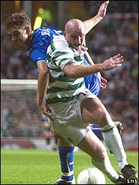 John Hartson powers past the Hungaria defence