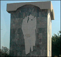 Damaged monument to Saddam Hussein