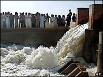 Water spews from a newly repaired pumping station in Iraq