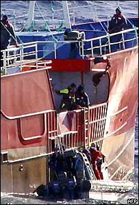Officers board ship. Image: AFP