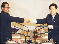 Chief North Korean negotiator Pak Chang Ryon, left, and Kim Gwang-lim, South Korea's deputy finance minister
