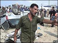 Palestinian policeman at bomb scene