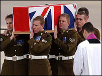 The coffin of one of the RMPs killed on 24 June