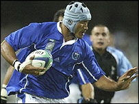 Samoa lock Opeta Palepoi on the charge against Uruguay