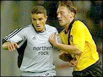 Goalscorer Laurent Robert (left) takes on NAC Breda's Pieter Collen