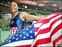 Kelli White celebrates her win in the 200m