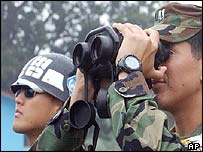South Korean soldiers watch their northern counterparts across the border