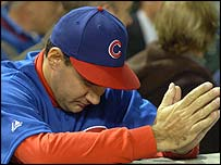 A Cubs fan seeks divine intervention as his team fall to the Marlins in Game Seven
