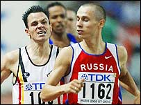Yuriy Borzakovskiy (right) cruises through his 800m heat in Paris