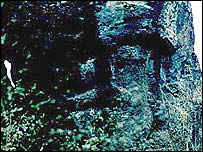 Prehistoric face carved on a rock wall, Gaietto