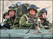 A Canadian battle group arrives at a suspected Taleban village on the lookout for hostile fire