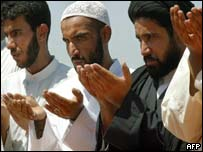 Shia Muslims pray at Friday prayers in Sadr City, a poor north-eastern suburb of Baghdad