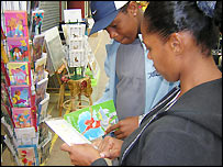 Shoppers browse the greeting card stall at Zabadi in Brixton Village