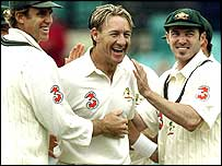 Andy Bichel celebrates the wicket of Trevor Gripper