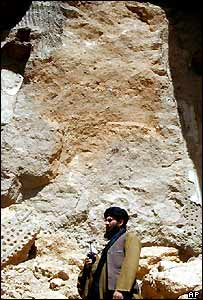 A Taleban soldier stands at the scene of destroyed Buddhas in Bamiyan, Afghanistan