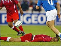 Tongan captain Inoke Afeaki lies unconscious in the game against Italy