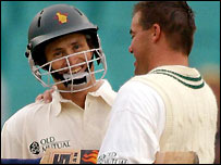 Carlisle is congratulated by Heath Streak