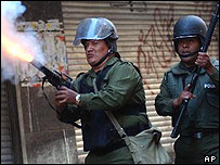Bolivian police officer fires tear gas at protesters in La Paz
