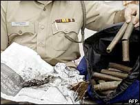 An Indian police officer shows the explosives