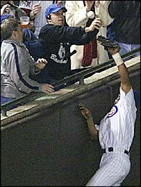 Steve Bartman foils Moises Alou's attempt to catch the crucial foul fly-ball